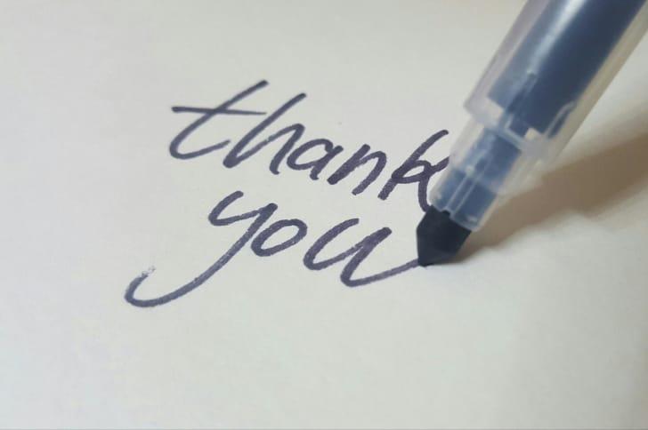フェルトペンで「thank you」と書かれている写真